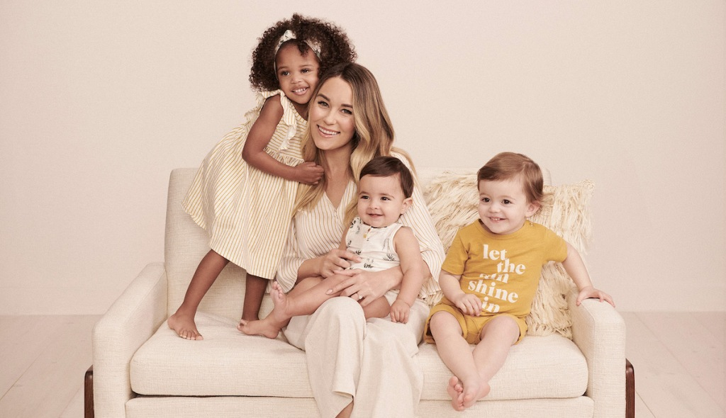 woman sitting on couch with kids