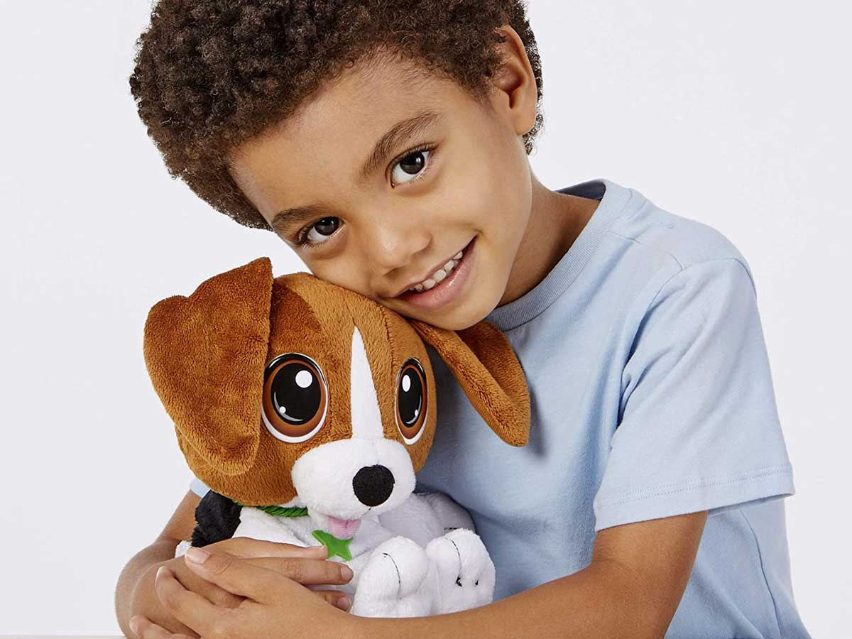 little boy hugging beagle plush dog