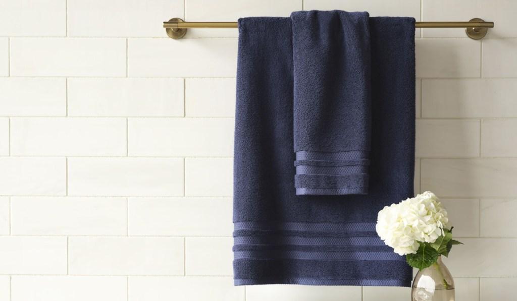 liz clairborne towels hung on pole