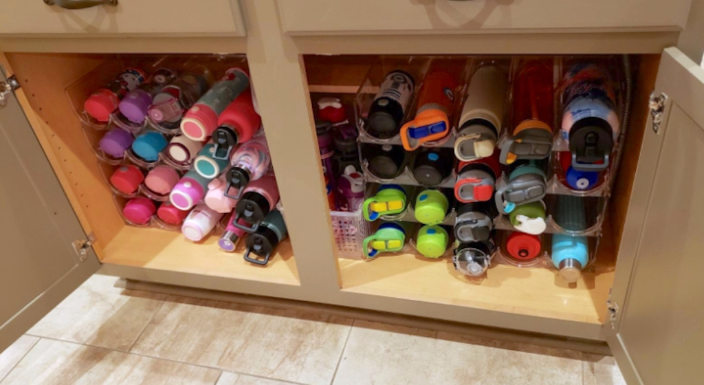 tons of water bottles in cabinet for pantry organization ideas