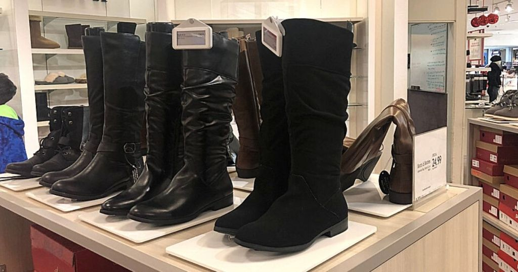 black riding boots on display
