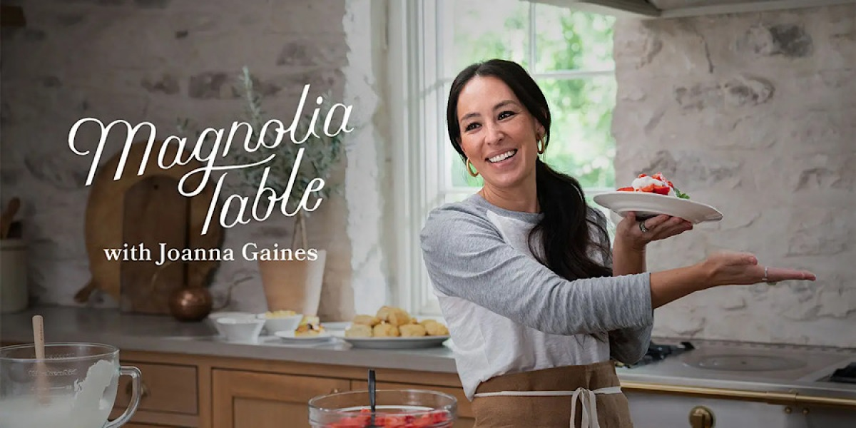 joanna gaines in her kitchen holding up a plate of food