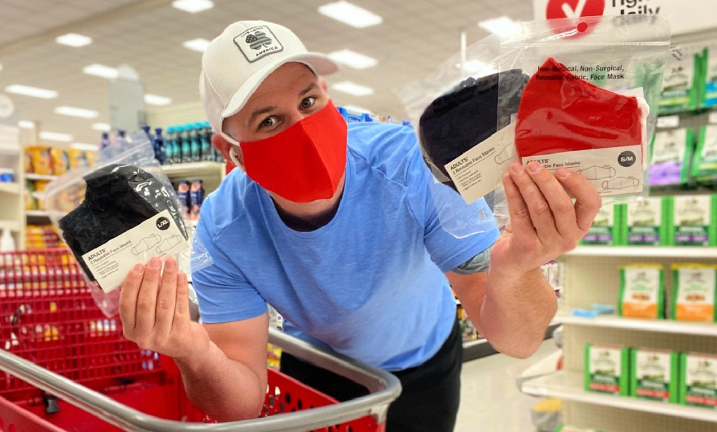 man holding face masks at Target