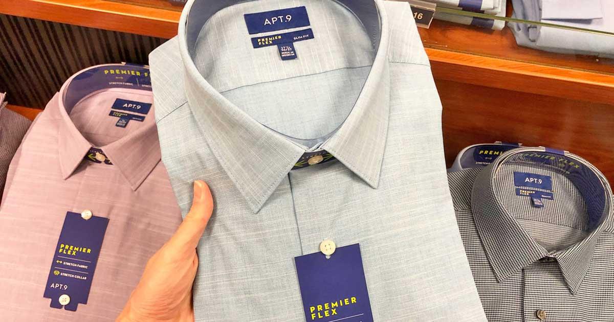 hand holding up a button down shirt