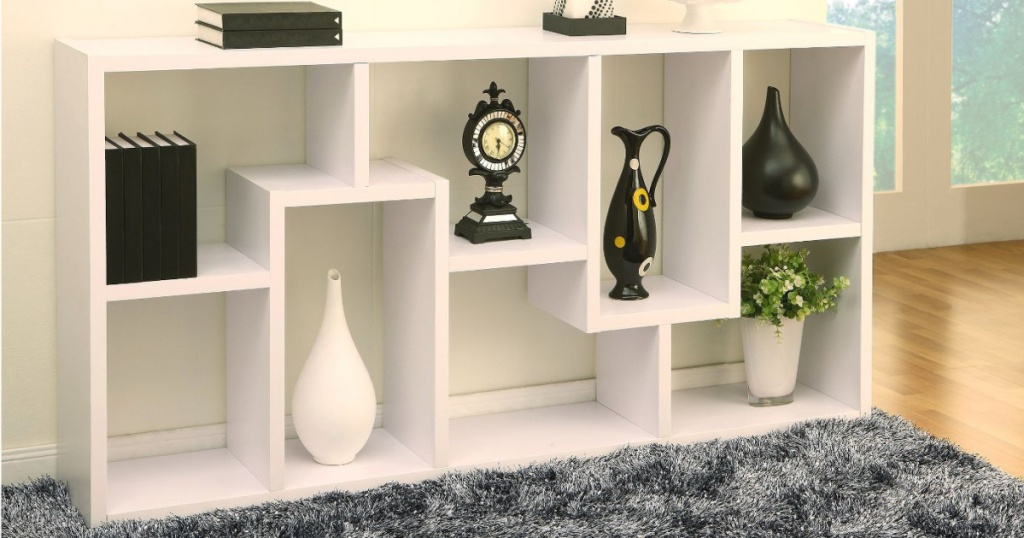 modern bookcase with things decorated