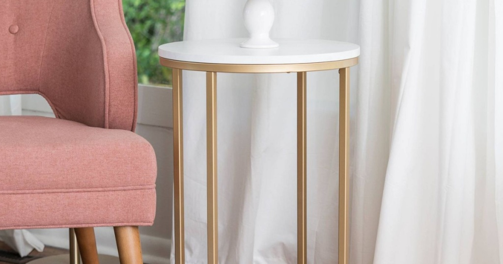 modern white and gold table beside chair