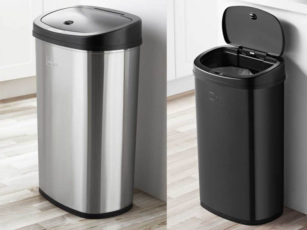 stainless steel and black trash cans in a kitchen