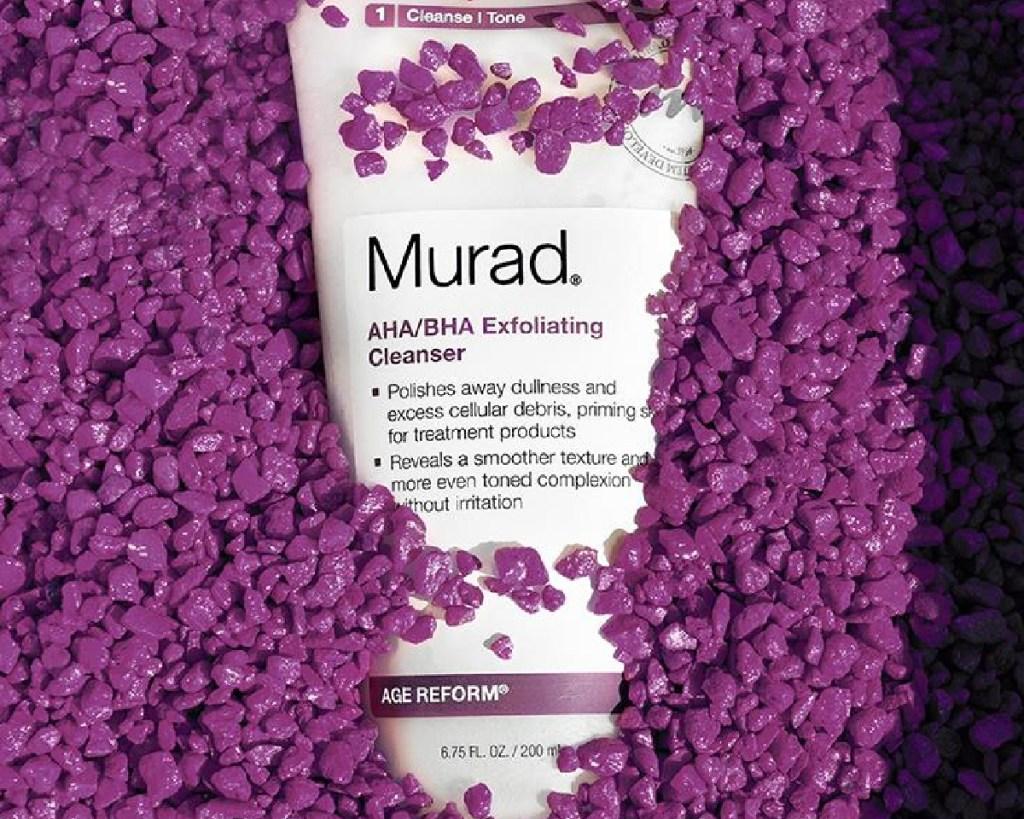 murad cleanser in purple fish tank rocks