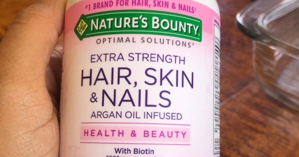 nature's bounty hair skin and nails bottle in hand
