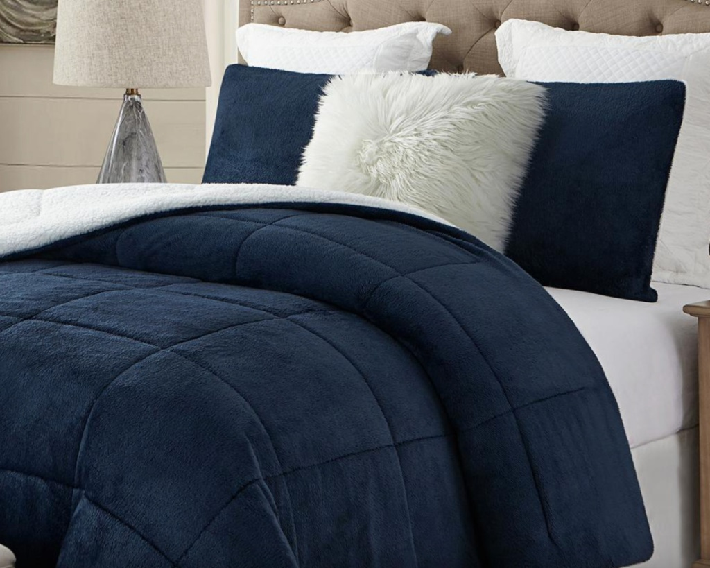 navy faux fur sham on bed