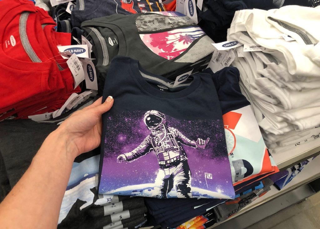 old navy boys graphic tees in hand in store