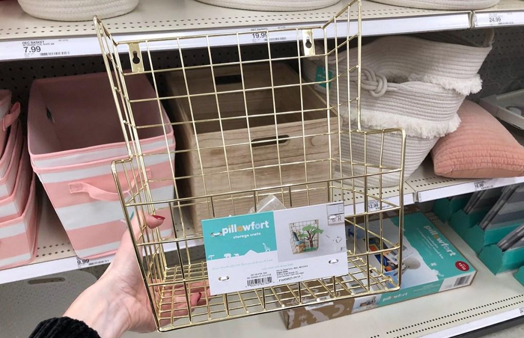 hand holding gold pillowfort storage basket