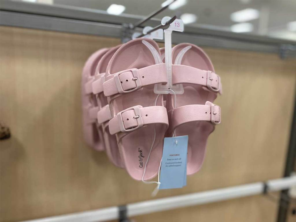 pair of pink sandals hanging up in store