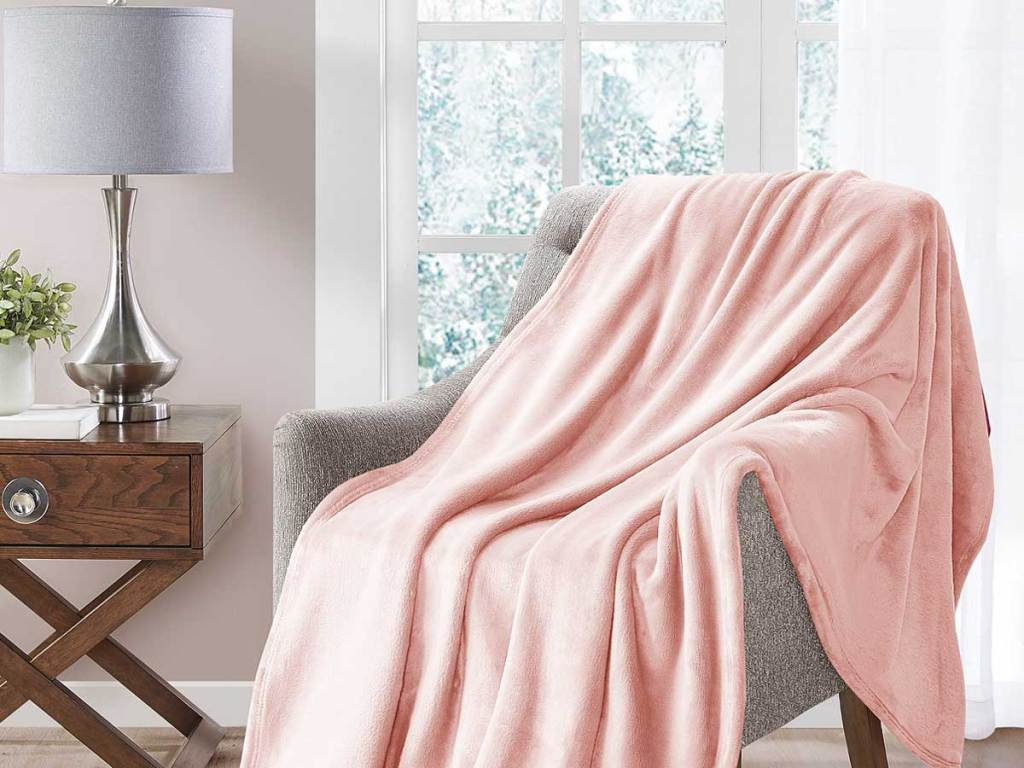 pink throw on chair in living room