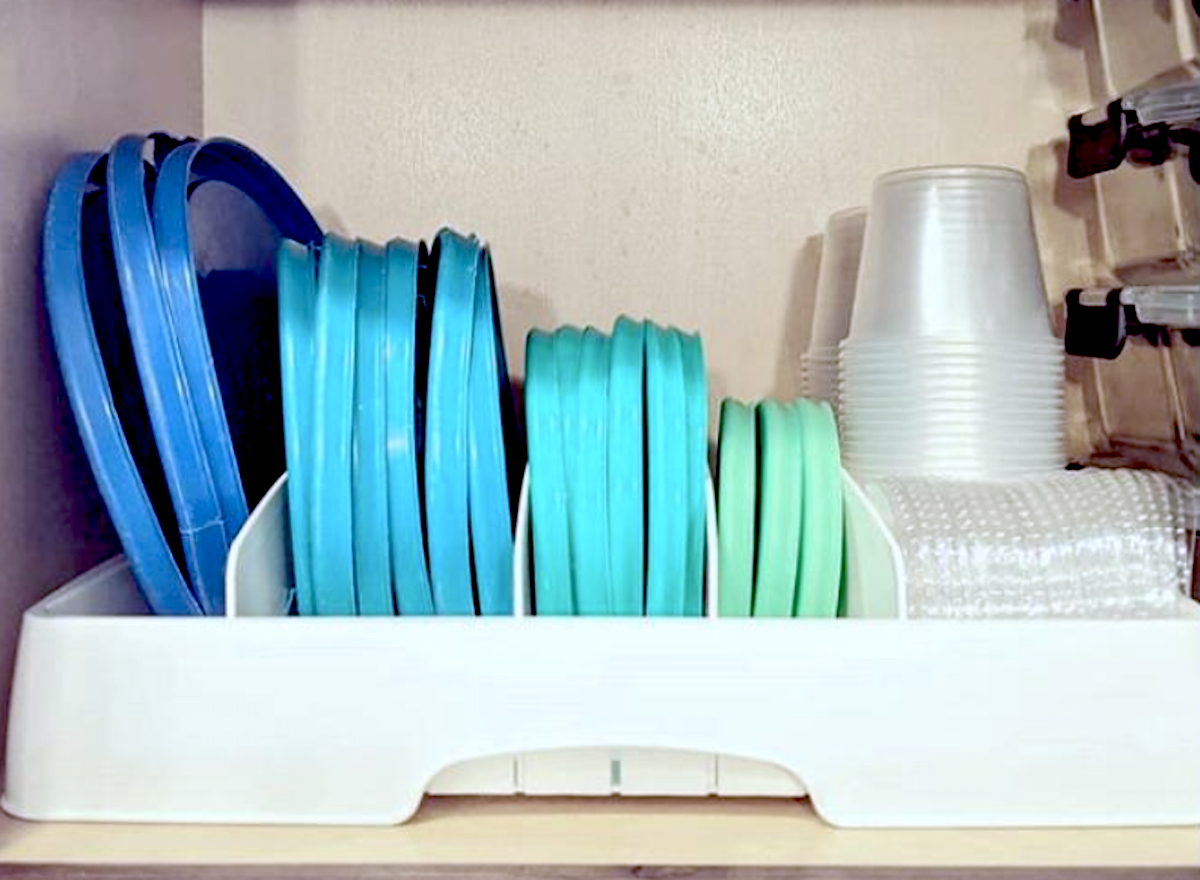 blue and green plastic lids in white storage organizer