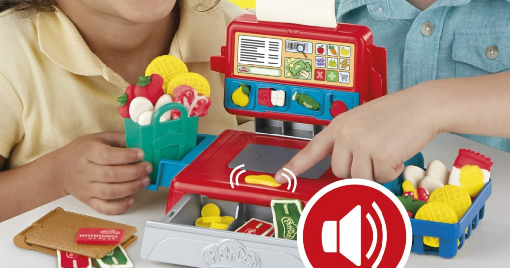 kids playing with play doh cash register