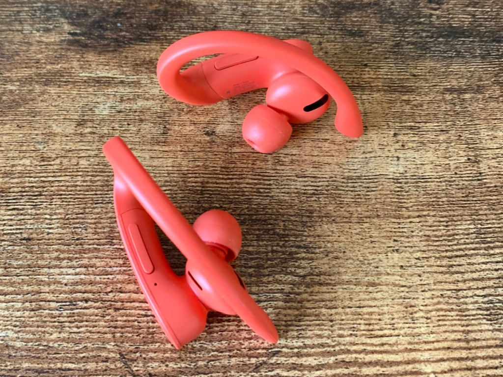 Pair of lava red wireless beats on wooden table