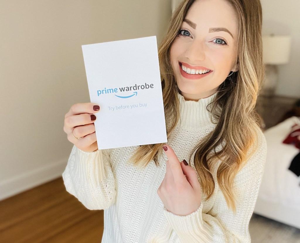 woman holding prime wardrobe paper