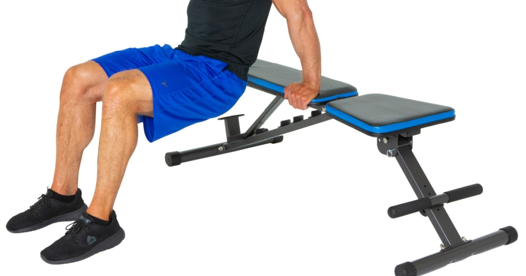 progear weight bench with man