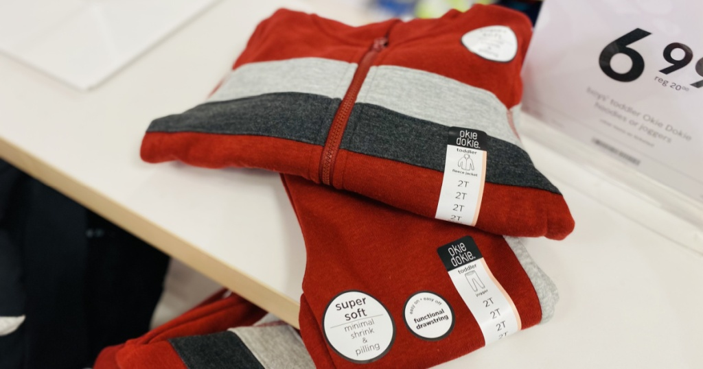 red pair of okie dokie sweater and pants with grey stripes