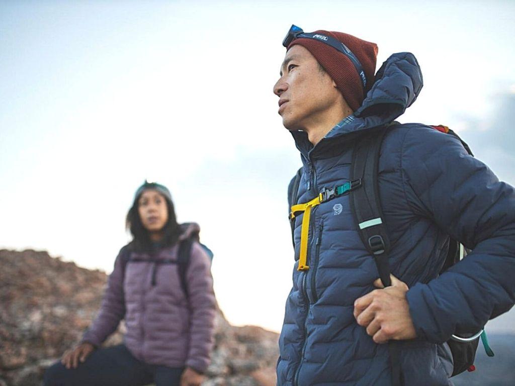 man hiking wearing blue puffer jacket