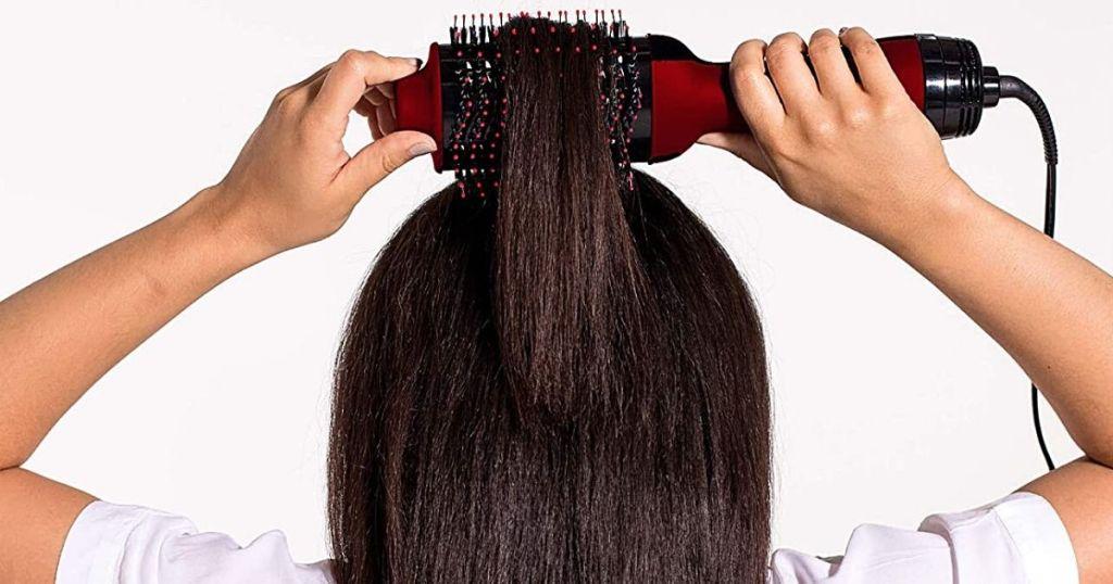woman using Revlon hairbrush on hair