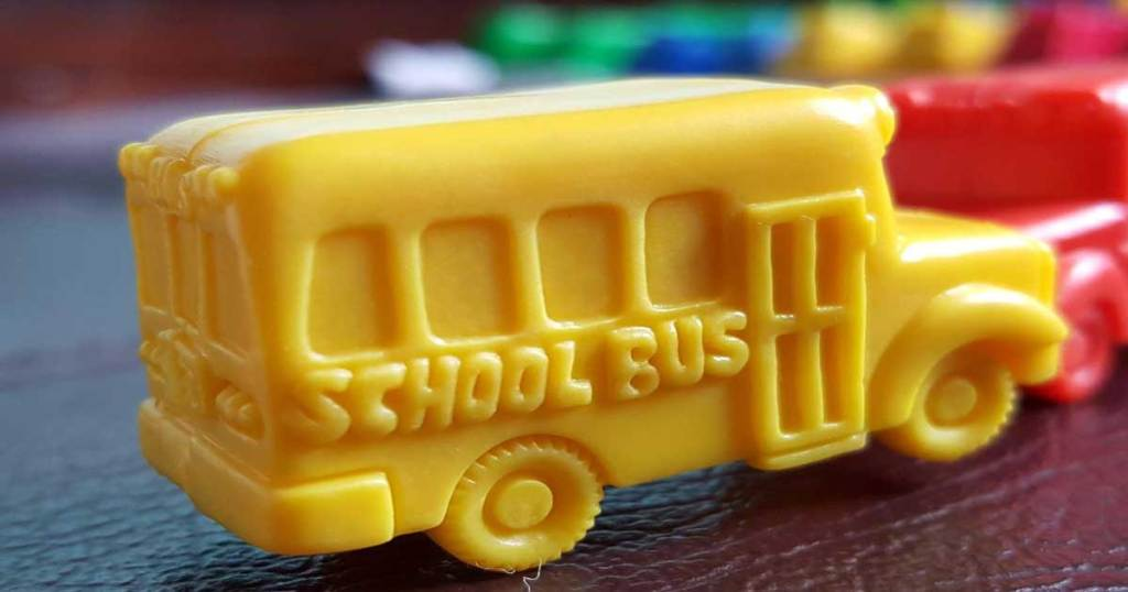 yellow school bus toy on table