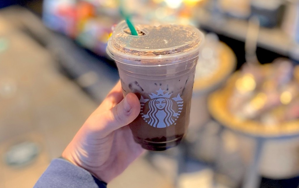 hand holding a starbucks drink in store