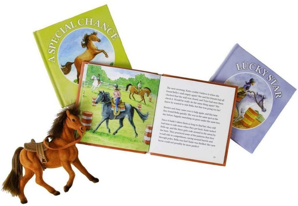 brown toy horse with open book and two closed books