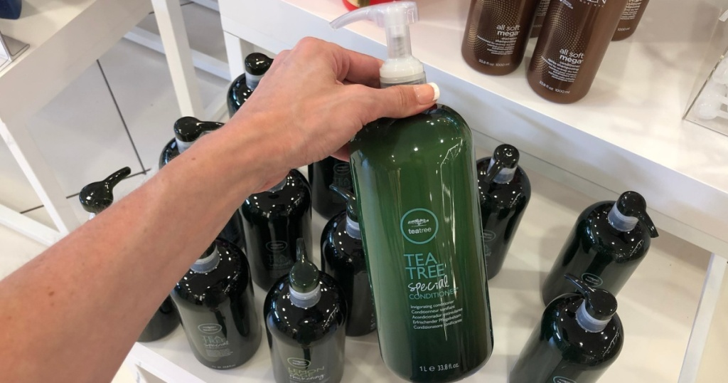 tea tree special shampoo in hand in store