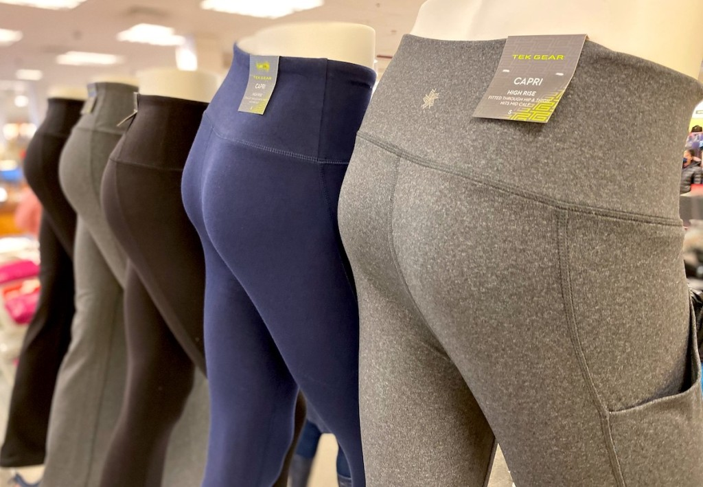 row of workout leggings on mannequins