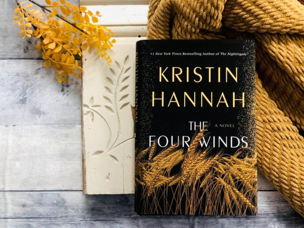 The Four Winds book next to blanket