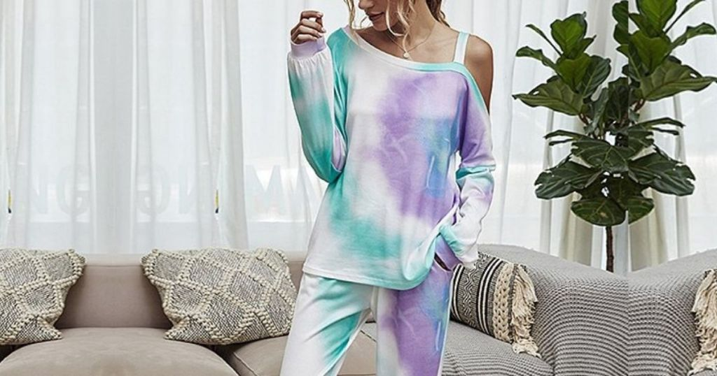 woman wearing tie dye outfit standing in front of couch