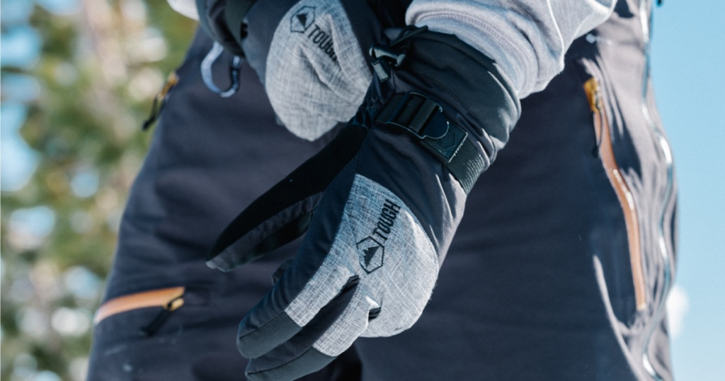 hand pulling on a pair of gloves