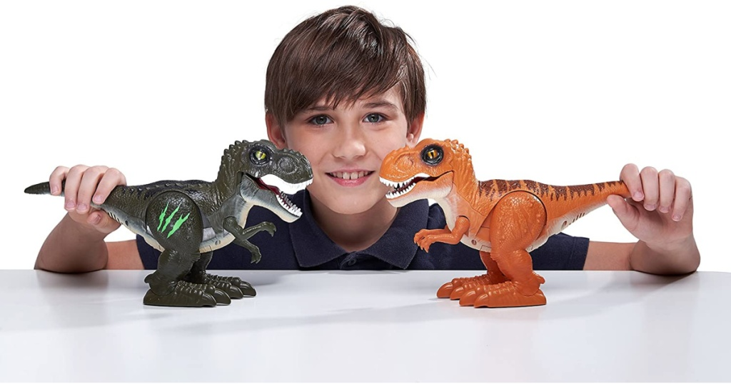 boy playing with two robo alive dinos