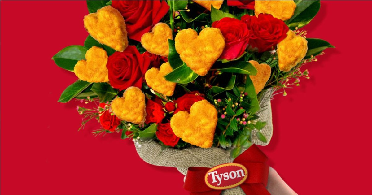 holding bouquet of roses and heart-shaped chicken nuggets