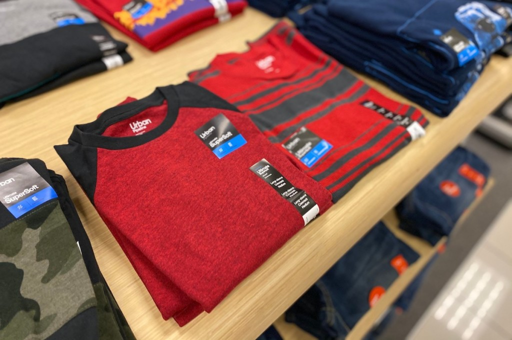 stacks of shirts from urban pipeline on store shelf