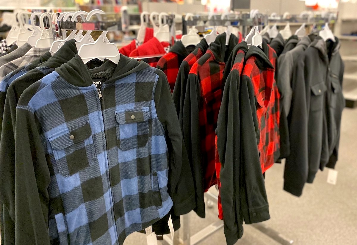 row of plaid and checked flannel zip up jackets