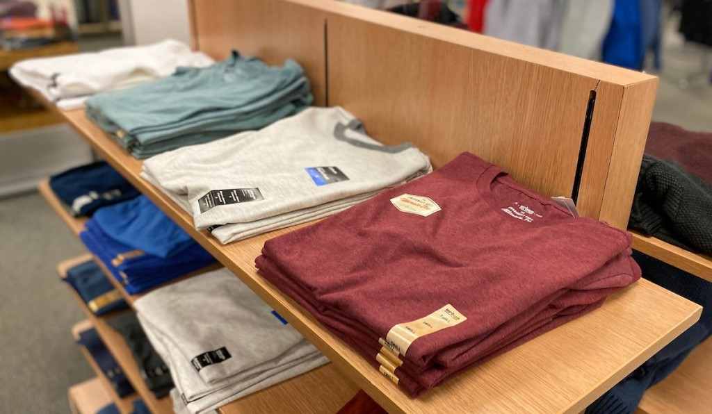 row of various colors urban pipeline t-shirts on store shelf