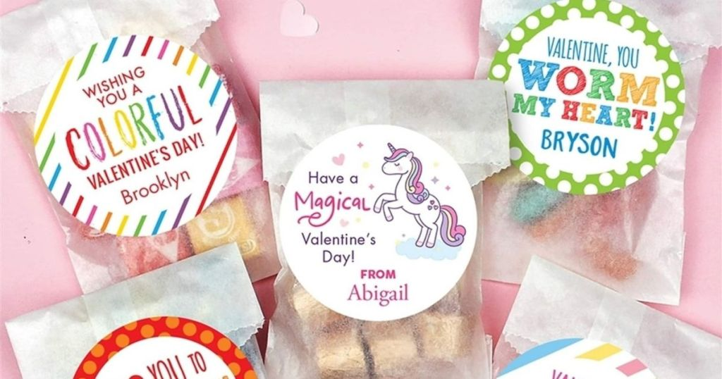 clear bags filled with treats and sealed with a personalized sticker
