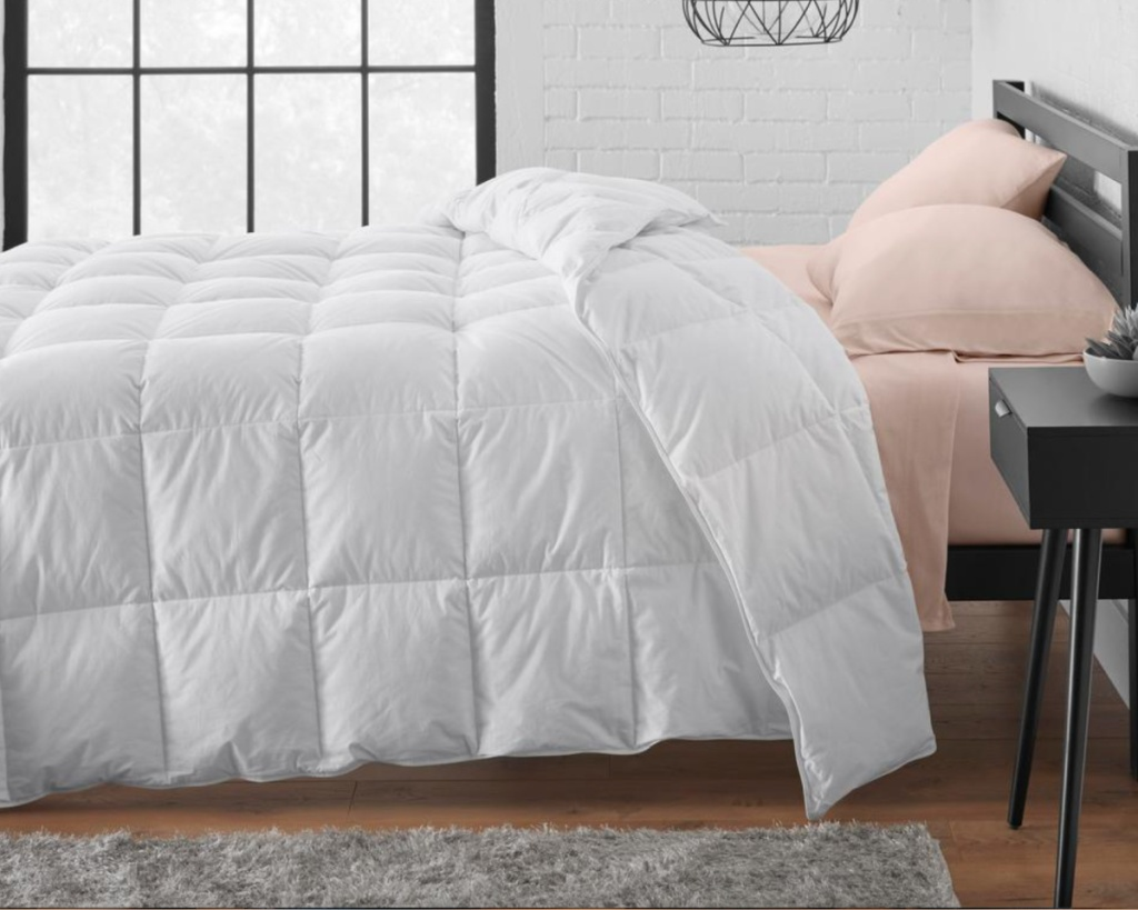 white feather down comforter on bed