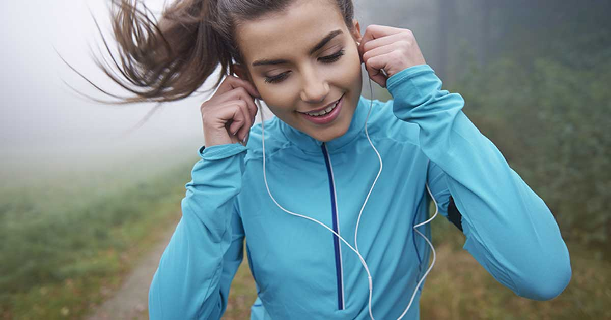 woman runner with ear phones on