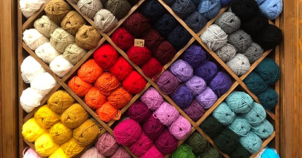 display of yarn on wall