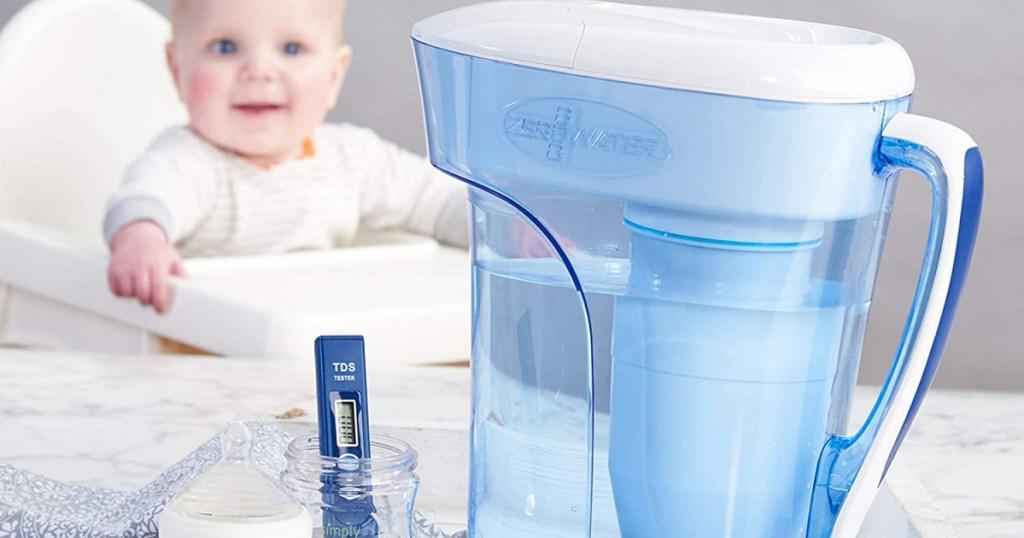 zerowater pitcher next to baby