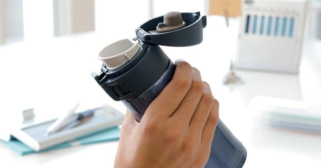 zojirushi mug in hand opened