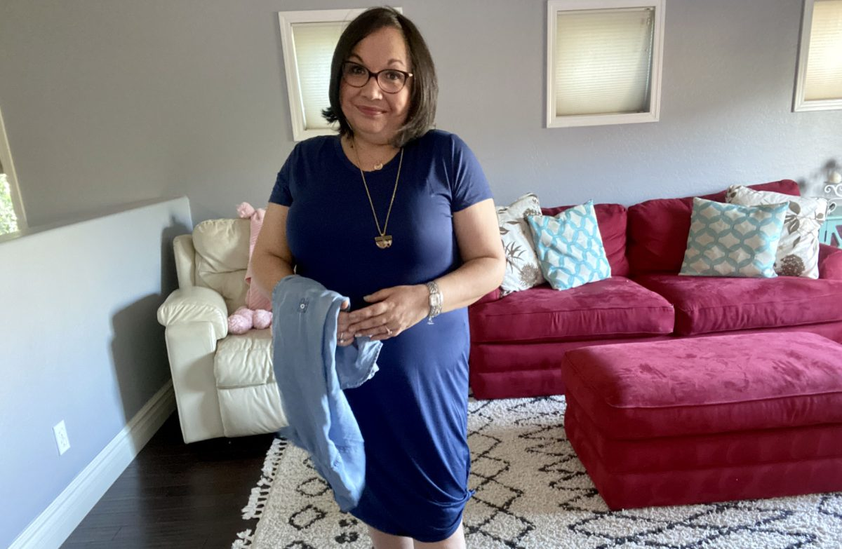 woman wearing a short sleeve blue t-shirt dress