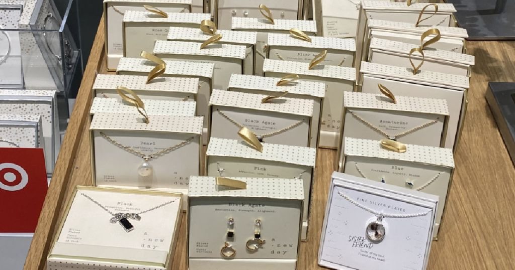 various gold boxes with jewelry on table