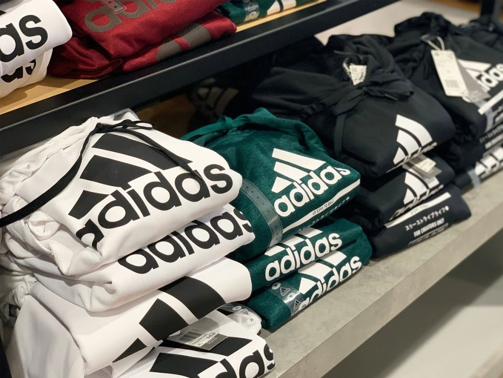 display of folded adidas hoodies