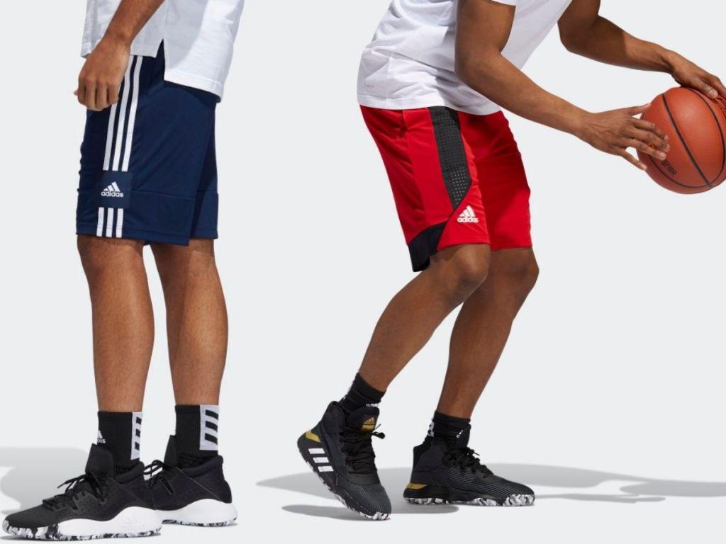 Two men wearing adidas mesh basketball shorts