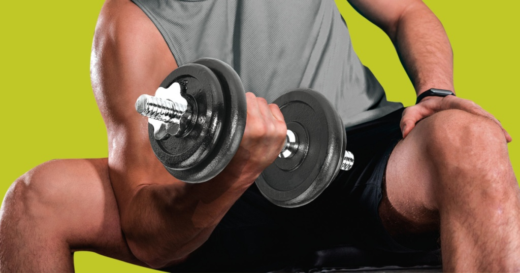 man in workout clothes lifting large dumbbell